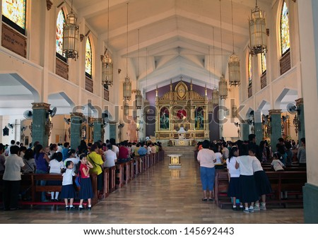 TACLOBAN PHILIPPINES JULY 10 2011 Unidentified Filipinos at Sunday mass in St Joseph Catholic Church on July 10 2011 at Tacloban Philippines Catholicism is the major religion of the country