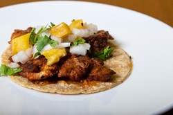 taco al pastor, mexican food isolated on a white plate