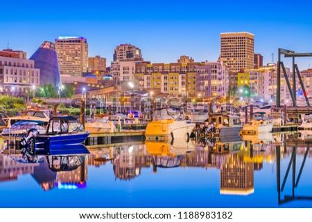 Tacoma, Washington, USA downtown skyline at dusk on Thea Foss Waterway.