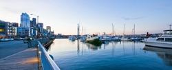 Tacoma waterfront near aquarium with marina and boats in early morning.