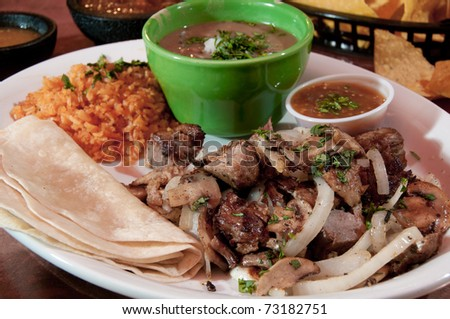 Tacos with re-fried beans and rice