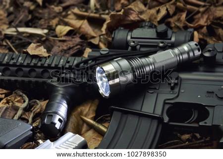 Tactical flash light and assault rifle gun weapon. LED Pocket flashlight. #1027898350
