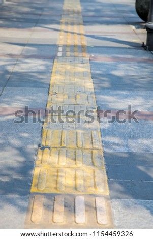 Tactile Paving, a System of Textured Ground Surface Indicator on Footpaths to Assist Pedestrians Who are Visually Impaired