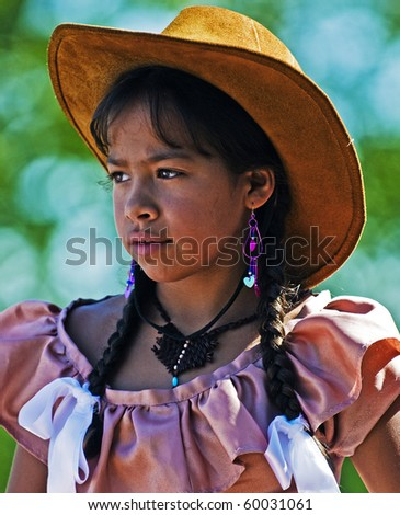 "TACUAREMBO, URUGUAY - MAR 6 : Participant in the annual festival ""Patria Gaucha"" March 6, 2010 in Tacuarembo, Uruguay. It is one of the biggest festival in South America to celebrate gaucho culture"