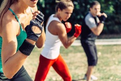 Taebo team doing uppercuts in training, selective focus