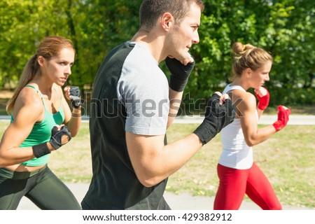 Taebo team in training, doing uppercut punch