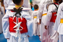 Taekwondo athletes with with uniform and red armour