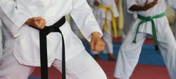 Taekwondo kids athletes. Moment of athlete to warm up and strike an opponent during the tournament taekwondo kids
