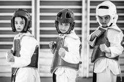 Taekwondo kids posing, looking at camera