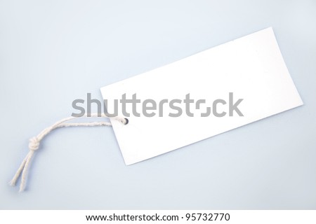 Tag and string on blue background