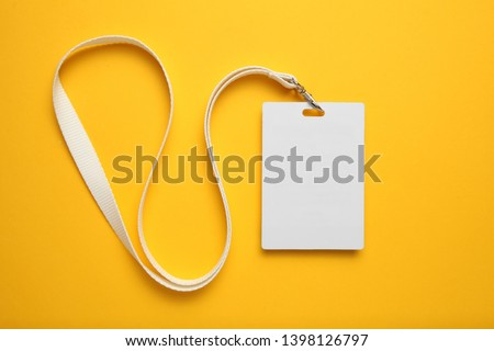 Tag id pass, plastic identification on yellow background. White blank badge mockup. #1398126797