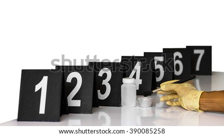 Tag number for forensic examination at the scene, along with accessories and hand gloves. #390085258