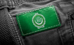 Tag on dark clothing in the form of the flag of the Arab League