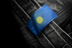 Tag on dark clothing in the form of the flag of the Commonwealth