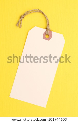 Tag or label on yellow paper background