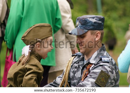 Taganrog, Rostov region, RUSSIA - MAY 09.2017: A meeting of the little father-daughter military officer near the eternal flame in the Park of culture and rest #735672190