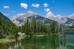 Taggart Lake is located in Grand Teton National Park, in the U. S. state of Wyoming. The natural lake is located at the terminus of Avalanche Canyon. A number of hiking trails can be found here.