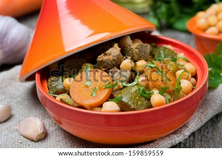 tagine with beef, chickpeas and vegetables, close-up, horizontal