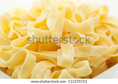 Tagliatelle Pasta on a White Plate