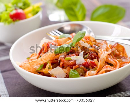 Tagliatelle pasta with tomato and vegetable sauce. Selective focus