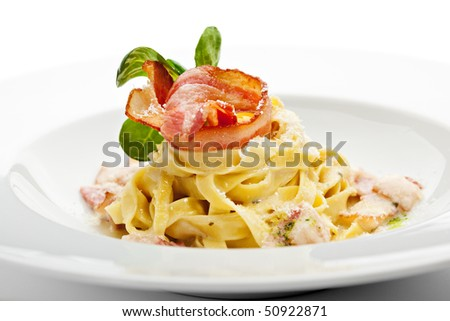 Tagliatelle with Carbonara Sauce, Bacon and Yolk of Quail Egg