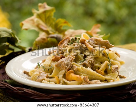Tagliatelle with chanterelle, parmesan and thyme. Selective focus