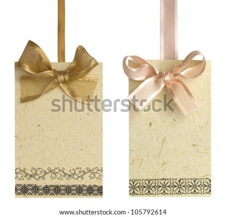 tags with bows isolated on the white