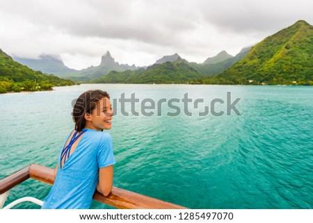 Tahiti cruise ship travel vacation woman on balcony of yacht traveling on exotic oceania adventure.