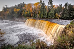Tahquamenon Falls autumn panorama during peak fall colors in the Upper Peninsula of Michigan.