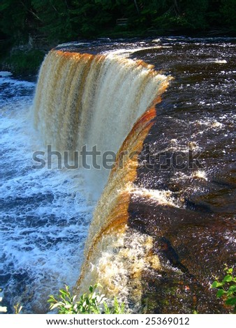 Tahquamenon Falls Rapids on river in Upper Peninsula, Michigan - stock photo