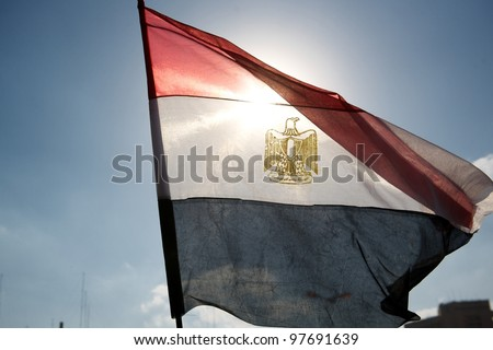 Tahrir square, Cairo, Egypt, January 2011, The Egyptian flag waving among the blue sky