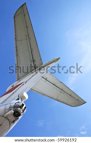 Tail of a jet airplane and sky - stock photo