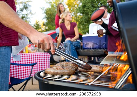 stock photo: man grilling at tailgate party