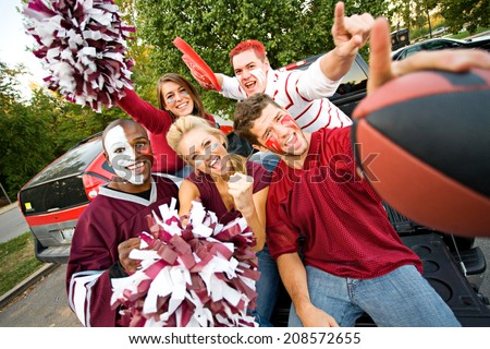 Tailgating: Group Of Excited Fans Cheer For Team