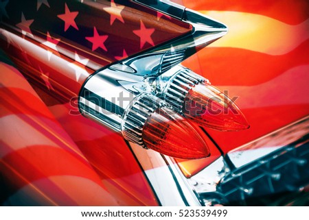 taillight of a classic American car with United States flag
