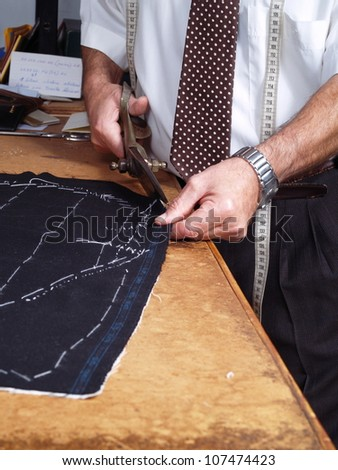 Tailor hands working in a coat.