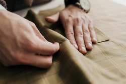 Tailor man working in his tailor shop, individual tailoring