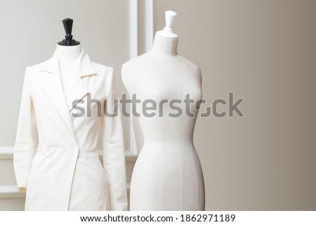 Tailor's textile mannequin in clothes designer show room Photo stock ©
