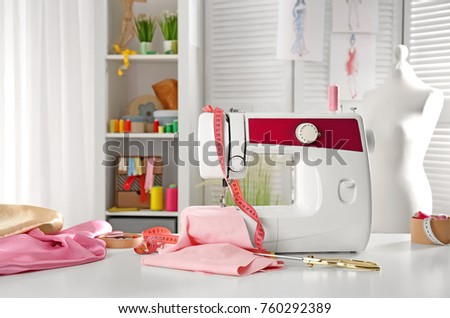 Tailor's workplace with modern sewing machine #760292389