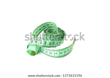 Tailoring centimeter tape twisted into a spiral isolated on a white background. Copy space