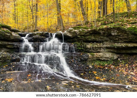 Tailwater Falls, a beautiful little waterfall in Owen County,  Indiana's Lieber State Recreation Area, cascades through a colorful autumn landscape. #786627091