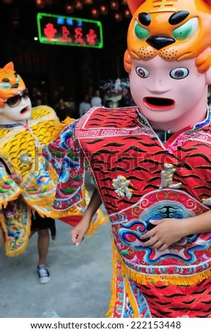 Tainan, Taiwan November 14th : Will jump as electronic dance music started dancing doll, Madou Matsu procession of energy performance on November 14th ,2010 in Tainan, Taiwan