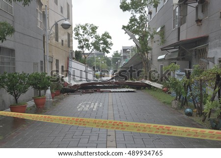 Tainan,Taiwan.September 28,2016. collapsed zinc wall. typhoon MEGI #489934765