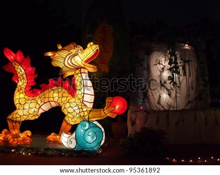 TAIPEI - FEBRUARY 11: novel Chinese lanterns light up celebrating Lantern Festival, known as Yuanxiao Festival, on Feb 11, 2012 in Taipei, Taiwan. It is held annually in January of Lunar calendar. - stock photo