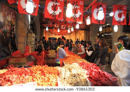 TAIPEI - January 18: Dihua Street--New Year's Market, the oldest street in Taipei (1850s).  It attracts more than 750,000 people in two weeks during the New Year,  January 18, 2012 in Taipei,Taiwan.