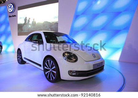 TAIPEI, TAIWAN - JANUARY 1: a 2012 new VW Beetle car at the 19th TAIPEI INT'L AUTO SHOW on January 1, 2012 in Taipei, Taiwan - stock photo