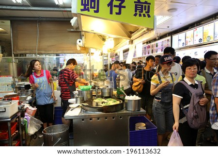 TAIPEI, TAIWAN-JULY 14: Hungry crowds flock to the Shilin Night Market food court in the Shilin District of Taipei July 14, 2013. Shilin Market is the most popular and largest night market in Taiwan.