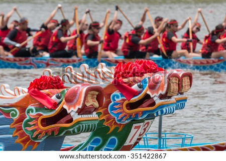 TAIPEI, TAIWAN - JUNE 2, 2014: A dragon boat team participates in the annual Dragon Boat race on Keelung River on June 2, 2014 in Taipei, Taiwan.