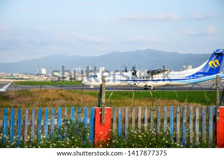 Taipei, Taiwan - Oct 21, 2018:The plane is preparing to take off on the runway. #1417877375