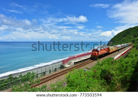 Taitung City, Taiwan, the train traveling along the coastline, a clear blue sky and white clouds and the ocean is a beautiful picture.